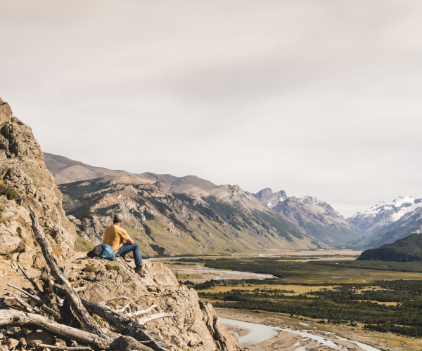male hiker looking at patagonia andes