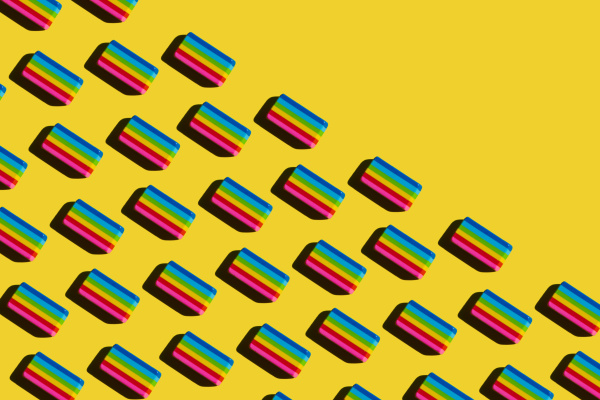 pattern of rainbow colored erasers against