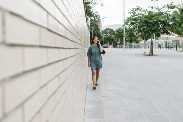 woman using smartphone while walking on