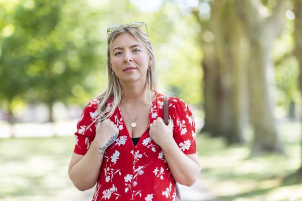 confident woman standing in public park