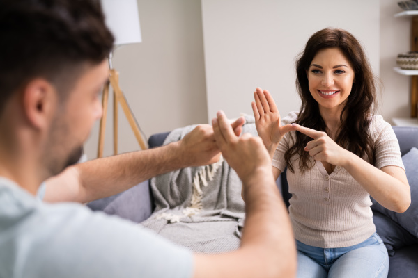 young deaf people using sign language