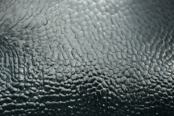 detail of iceberg carved by wind