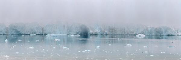 glacier face in early morning fog