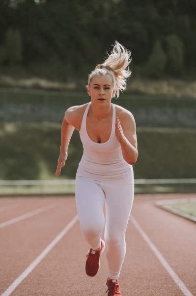woman running on a track wellington