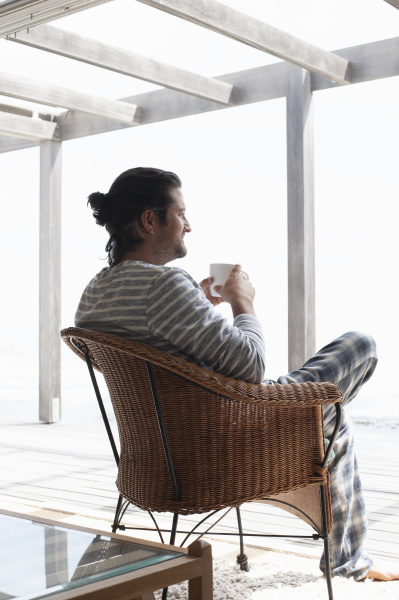 a man sitting in a rattan