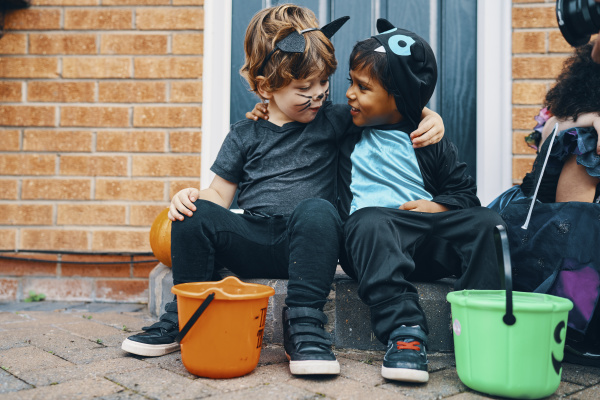 two children dressed for halloween with