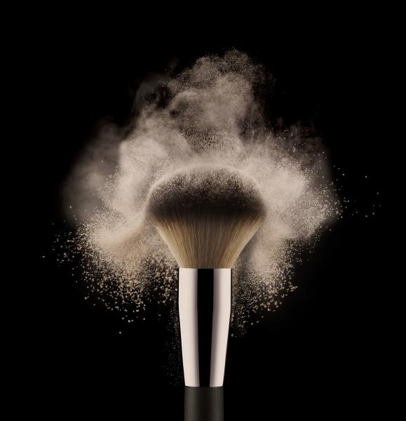 close up of cosmetic powder brush