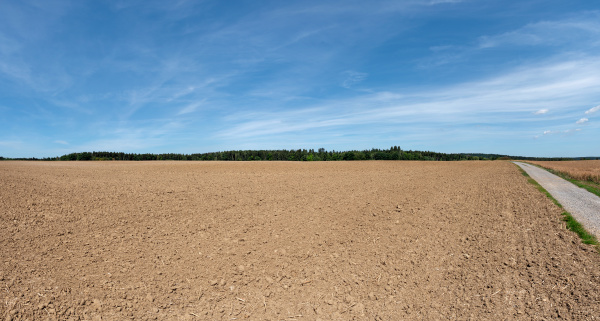 large cultivated newly harrowed field of
