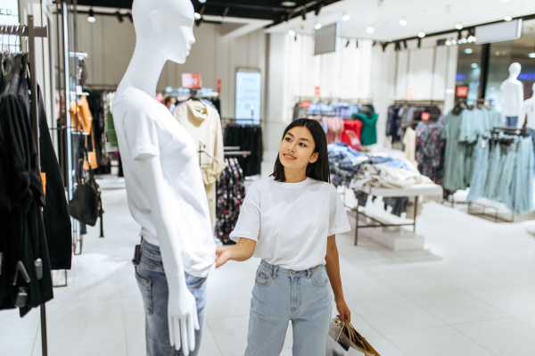 woman standing at the mannequin clothing