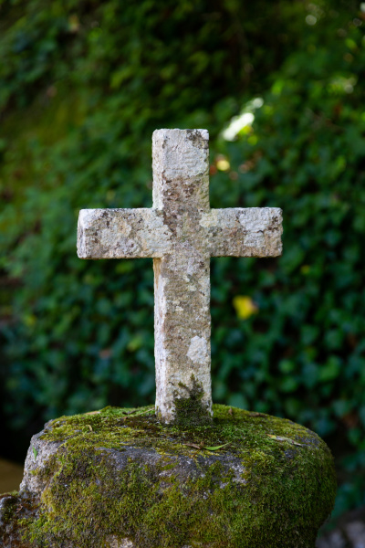 old stone catholic cross in the