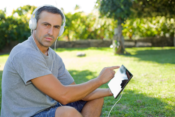 man relaxing with tablet pc