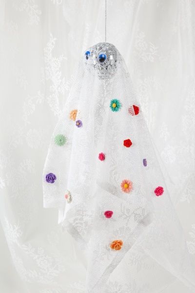 ghost in lace curtain with flowers