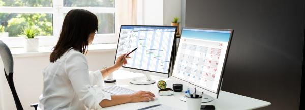 employee working on calendar schedule