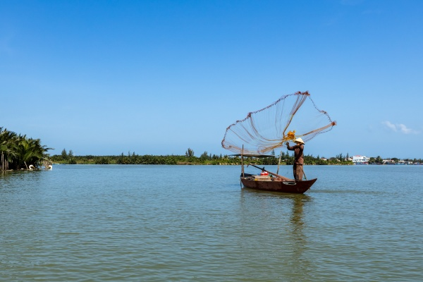 a traditional fisherman is throwing a