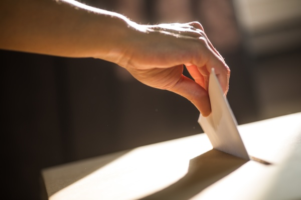 conceptual image of a person voting