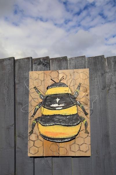 painted bee on wood