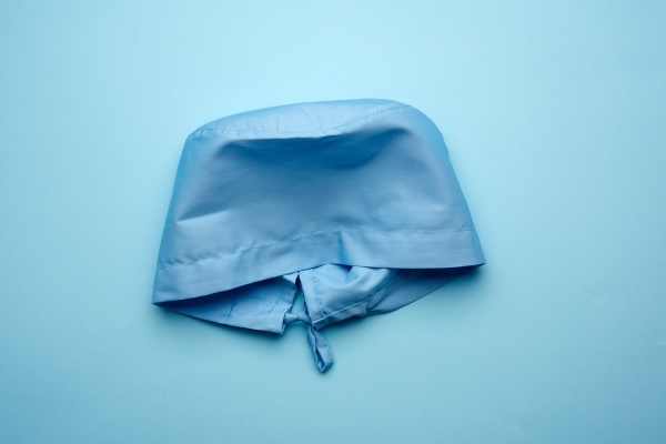 blue textile medical cap with ties