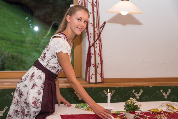 waitress sets the celebratory table in