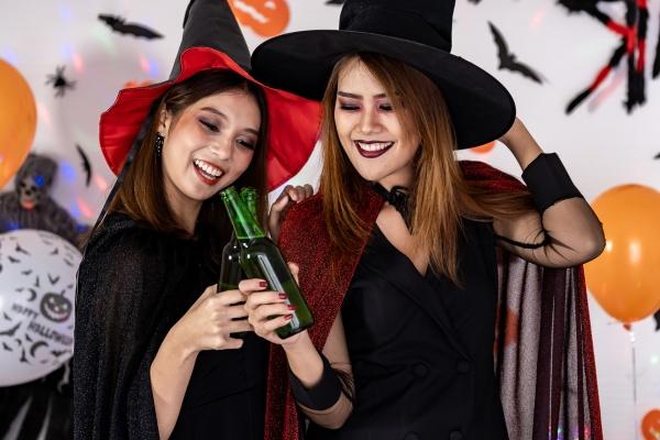 asian women celebrate cheers in halloween