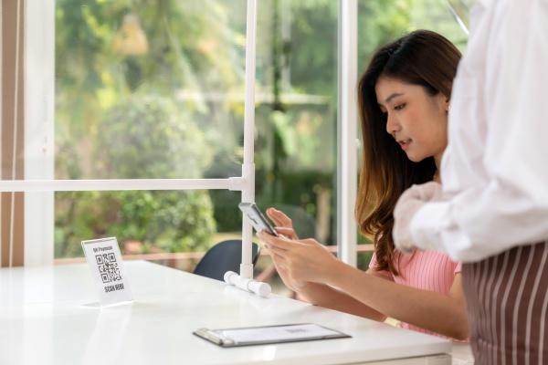 asian customer scan qr code to