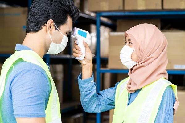 islam muslim asian warehouse worker taking