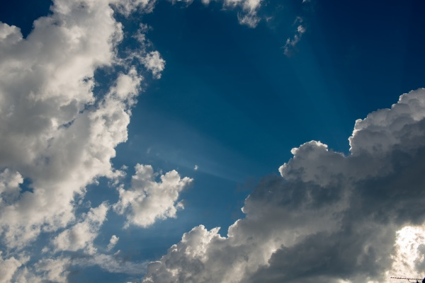 white whispy clouds and blue sky