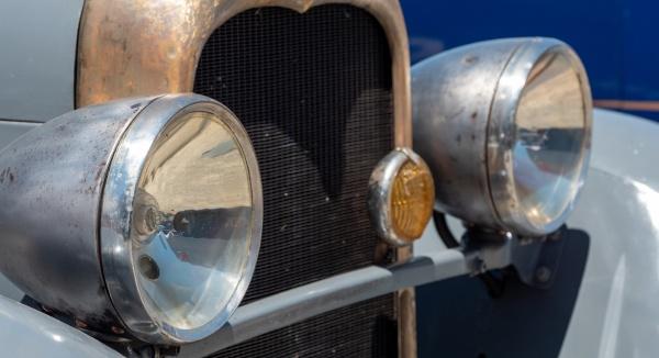 close up of antique car headlamps