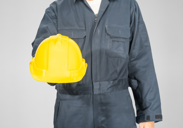 close up worker standing in blue