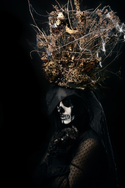 woman in black clothes and skull