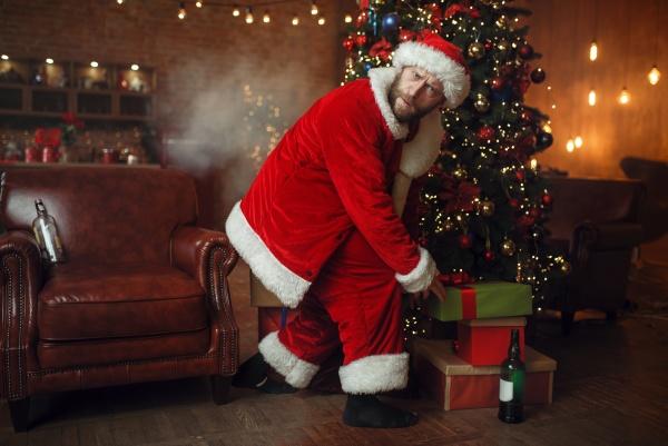 bad drunk santa steals gifts under