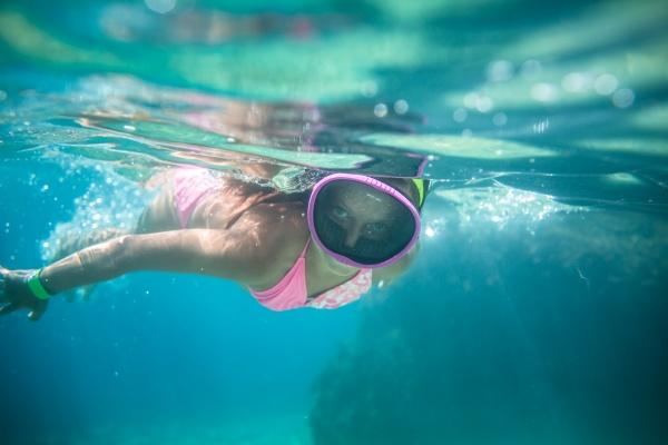little girl swimming underwater in the