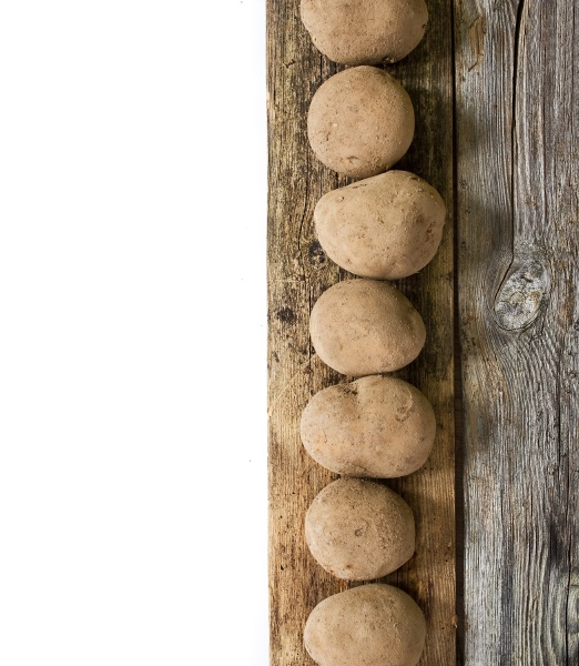 potatoes on wooden board