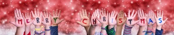 children hands building word merry christmas