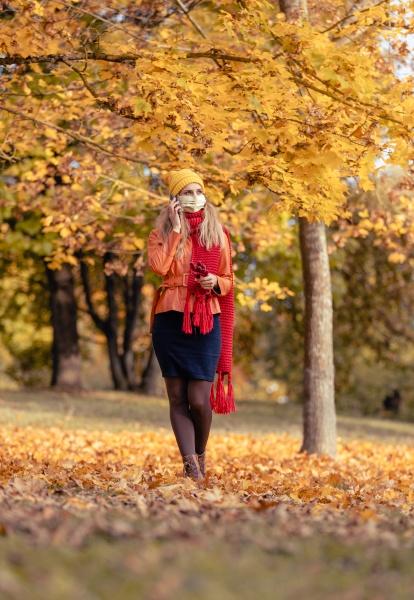 woman using her phone having walk