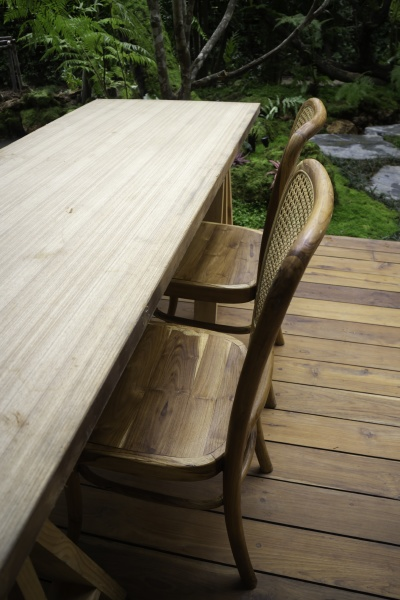 wooden table and chairs in tropical