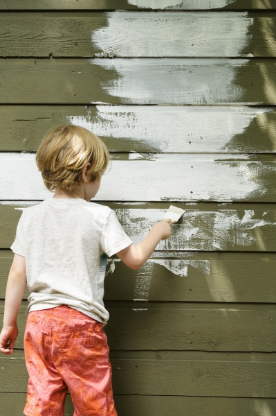 boy 4 5 painting cottage wall