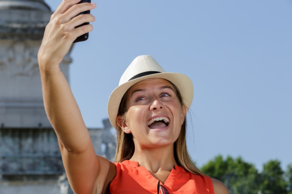 young female tourist taking selfie