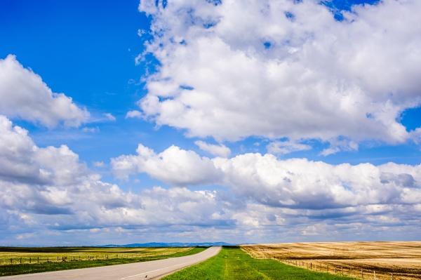 empty road on prairie under blue