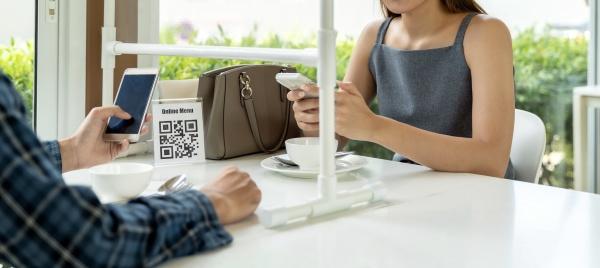 asian customer scanning qr code for