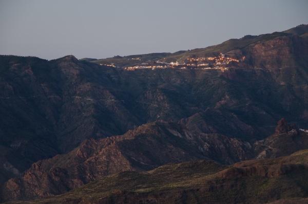 town of artenara at sunset in