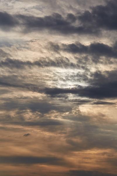 sunset through cloudy dramatic sky