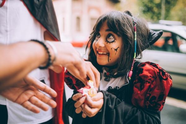 girl in halloween costume trick or