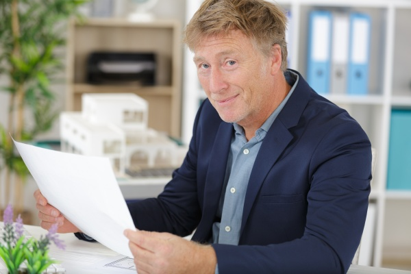 adult businessman in suit is laboring