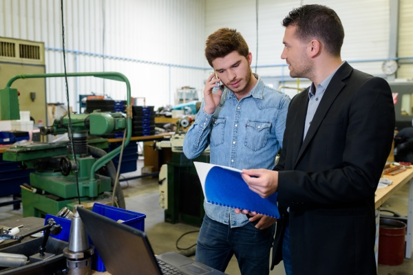 engineer and apprentice in factory