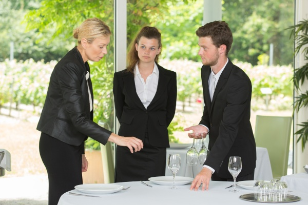 group of waiters and waitresses at
