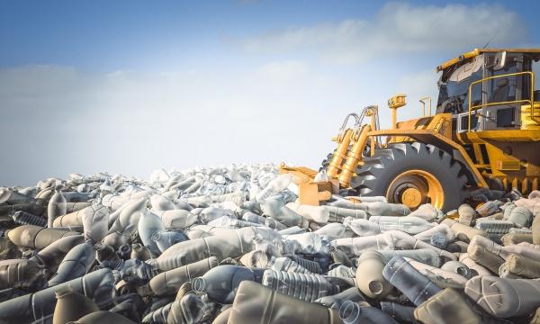bulldozer mouve mountains of plastic bottles