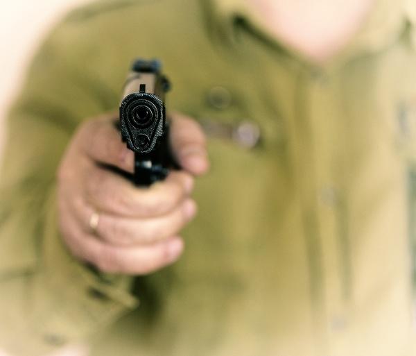 man pointing gun at the target