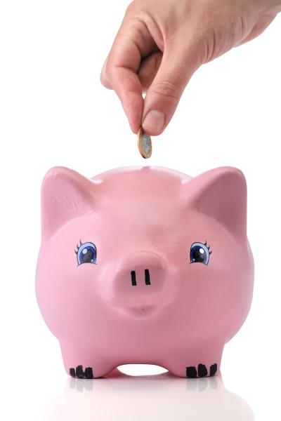 savings pink piggy bank on white