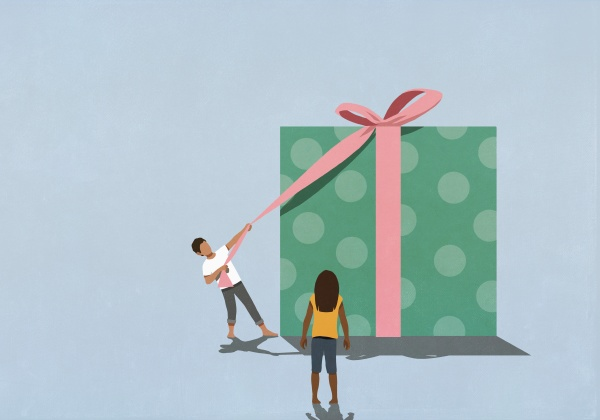 woman watching husband open large gift
