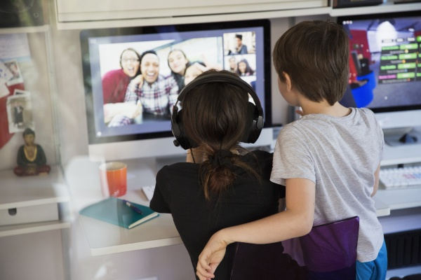 kids video conferencing with friends on